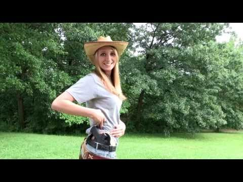 Emily shooting for Hidden Hybrid Holsters the Glock 30s and M&P Shield