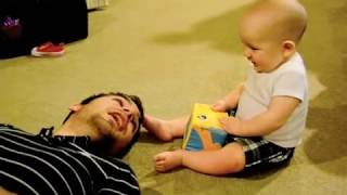 Baby laughing at Daddy sneezing