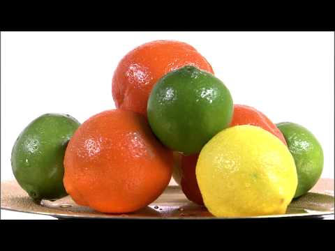 Citrus fruits on a spinning plate on a white screen.