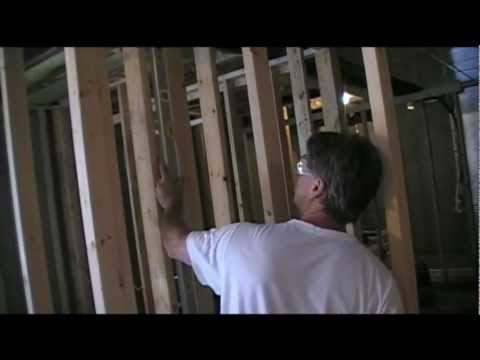 Watch and learn how to fasten your newly framed basement walls into final position. It's easy when you have the right tools for basement finishing. The Ramset Gun and the Framing Air Nail Gun are two basement finishing tools you will surely  want to have in your Tool Box!