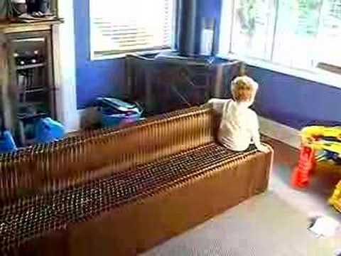 3 year old boy Moving a paper couch