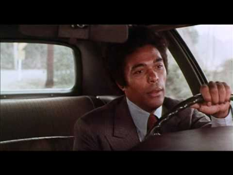 Theatrical trailer for The Thing With Two Heads (1972), with Ray Milland and Rosey Grier.