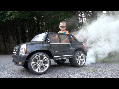epic cadillac escalade burnout this little kid is the ultimate boss on track