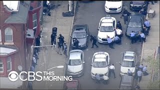 Nightlong standoff paralyzes Philadelphia neighborhood