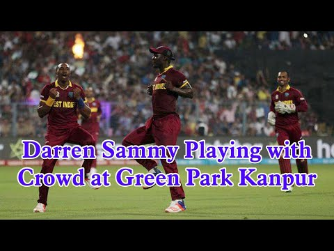 Darren Sammy playing with crowd at Green park Kanpur