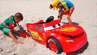Nikita ride on race car toy and stuck in the sand
