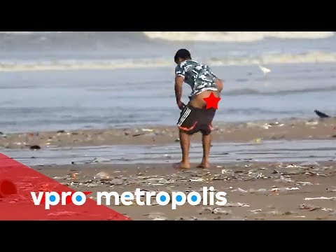 Pooping on the beach in India