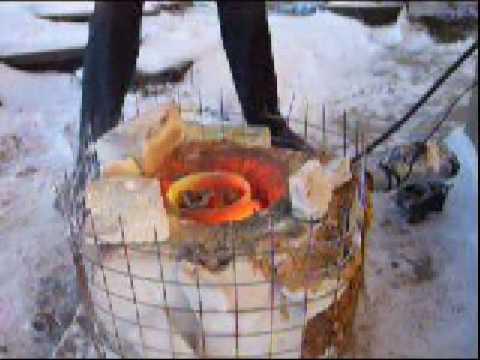 Melting aluminium at homemade easy foundry furnace and crucible