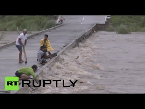 Floods & Landslides: 'Typhoon Koppu' slams into the Philippines