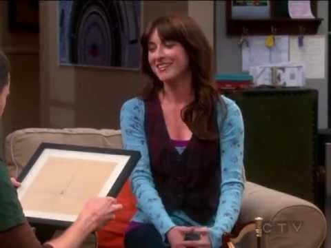 Alex showing Sheldon the presents that she got Sheldon to give to Amy