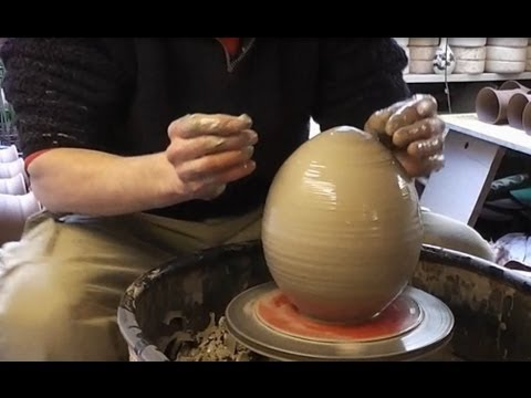 Throwing Making a giant pottery Easter egg on the wheel