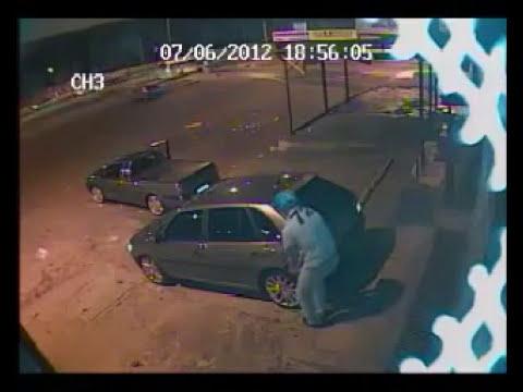 Câmera de segurança flagra tentativa de assalto e troca de tiros