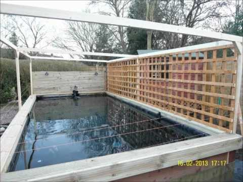 Raised koi pond youtube for Wooden koi pond construction