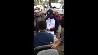 Tiger Woods signs autograph for fan