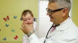 "How To Calm A Crying Baby - Dr. Robert Hamilton Demonstrates ""The Hold"" (Official)"