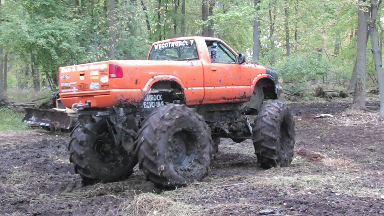 4x4 Ford Trucks Mudding Big Orange 4x4 Truck Mudding