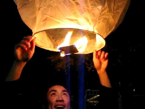 Magically and Beautiful UFO Fire Sky Lantern Balloon Flying on the Sky at Night