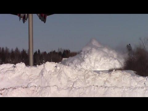 Train plows through snow bank