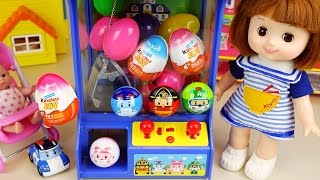 Poli surprise eggs crane machine and Baby doll, Kinder Joy toys