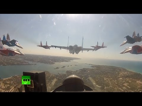 Crimea celebrated the 69th anniversary of Victory over Nazi Germany in the Great Patriotic War (WWII) with some awe inspiring stunts from Russian aviation ac...