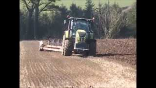 Claas Axion 810 with Kverneland 7 furrow plough