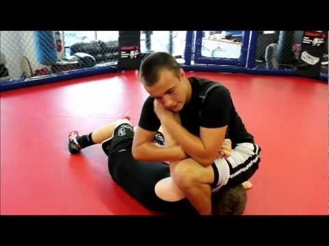 How to do Four Arm Bars from Side Mount - Submission Grappling, Clearwater, FL Image 1