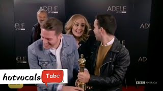 Adele Surprises fans while they take a picture with her Oscar