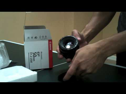 Here's a video of me un-boxing my Canon 50m 1.4 lens and placing it on my T2i (now 60D). This was filmed on my Kodak Playsport in October of 2010.