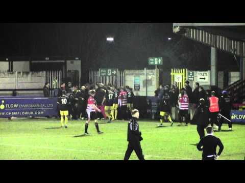 Kingstonian goalkeeper jumps advertising boards