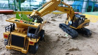 Kids' excavator & toy truck for kids in the sandpit.