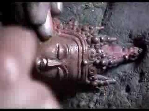 Carving of a tibetan Buddha statue