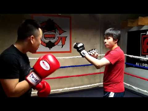 Wing Chun (red shirt) vs Muay Thai Sparring Image 1