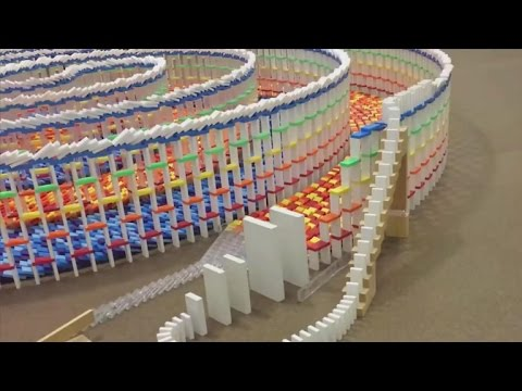 Triple spiral of dominoes falling mesmerizes the internet