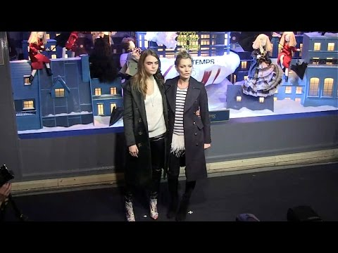 Kate Moss and Cara Delevingne have fun at Christmas windows opening in Paris