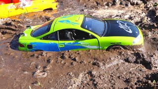 Toy Trucks Transporting helps stuck cars in the mud + Car Wash Video For Kids