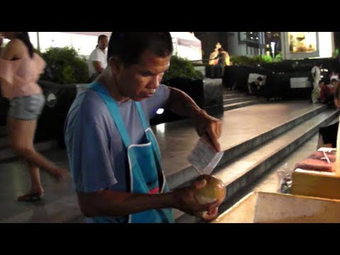 Bangkok Street Food by Night. The Coconut Juce Stall. Thailand