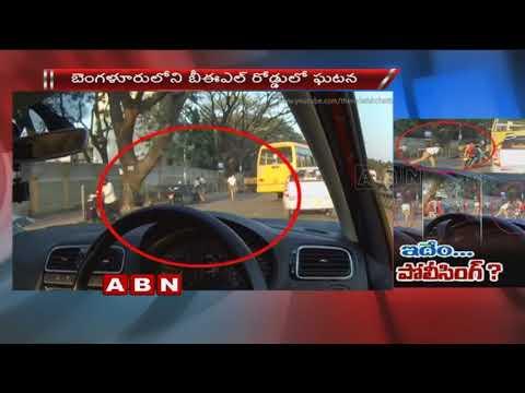 Bengaluru Cop Throws Shoe At Bikers For Not Wearing Helmets |  ABN Telugu