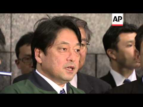 Japan ministers on NKorea crisis, small peace protest in Seoul
