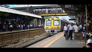 Churchgate fast local train crossing Goregaon Station