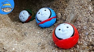The Thomas train turned into a ball. The ball rolls out of the cave.