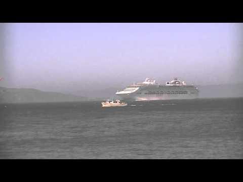 cruise ship sailing under Golden Gate Bridge