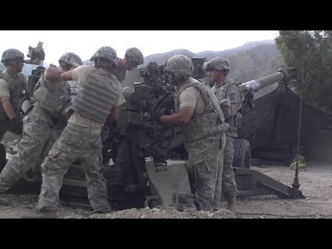 M777 ARTILLERY FIRES DIRECTLY AT TALIBAN POSITION
