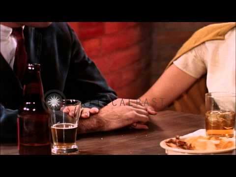 Men and women drinking and eating at a restaurant in United States. HD Stock Footage