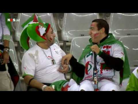 Algerian fan blows in friends ear with a Vuvuzela [2010 World Cup]