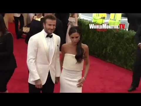 David Beckham greets Police officers arriving with Victoria Beckham at 2014 Met Gala