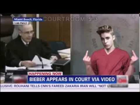 Justin Bieber Court Video shows. burns and throw money, and flip the double bird to the judge