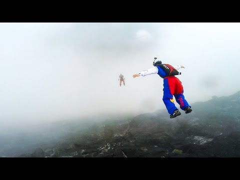 Cloudy Sky Base Jump in Norway