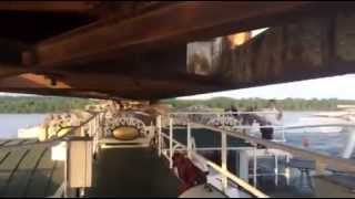 Steamboat American Queen Passing Under Bridge With Inches to Spare