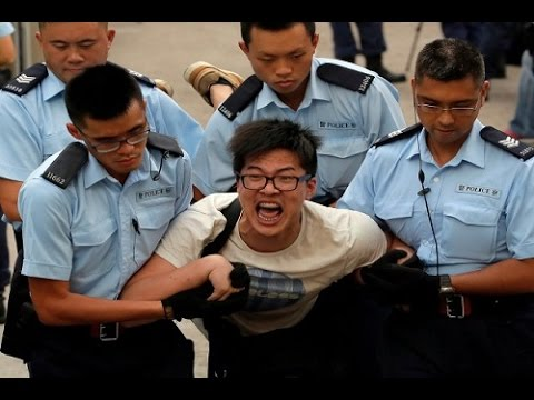 Hong Kong student protesters face off with riot police