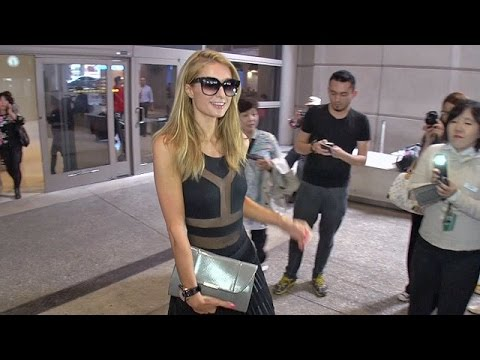 Paris Hilton Looking Sexy, Wearing Boyfriend's Watch At LAX